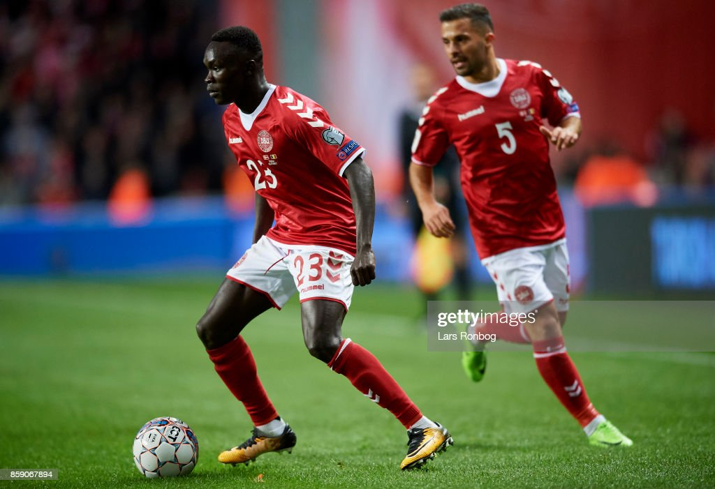 Pione Sisto and Riza Durmisi of Denmark in action during the FIFA World Cup 2018 qualifier match between Denmark and Romania at Telia Parken Stadium on October 8, 2017 in Copenhagen, Denmark.