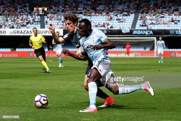 Pione Sisto forward of Celta de Vigo battles for the ball with Alvaro Odriozola midfielder of Real Sociedad de Futbol during the La Liga Santander...