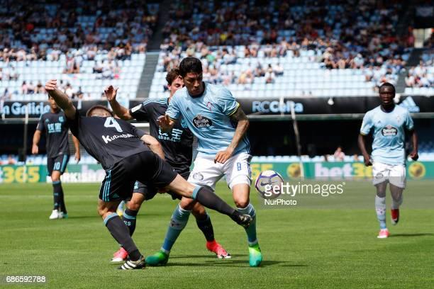 Pione Sisto forward of Celta de Vigo battles for the ball with Asier Illarramendi midfielder of Real Sociedad de Futbol during the La Liga Santander...