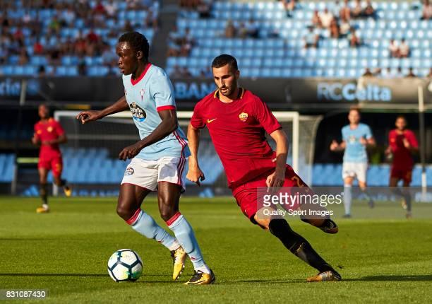 Pione Sisto of Celta de Vigo beats Maxime Gonalons of AS Roma during the preseason friendly match between Celta de Vigo and AS Roma at Balaidos...