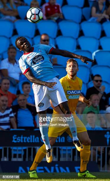 Pione Sisto of Celta de Vigo is challeged by Cyril Thereau of Udinese Calcio during the Pre Season Friendly match between Celta de Vigo and Udinese...