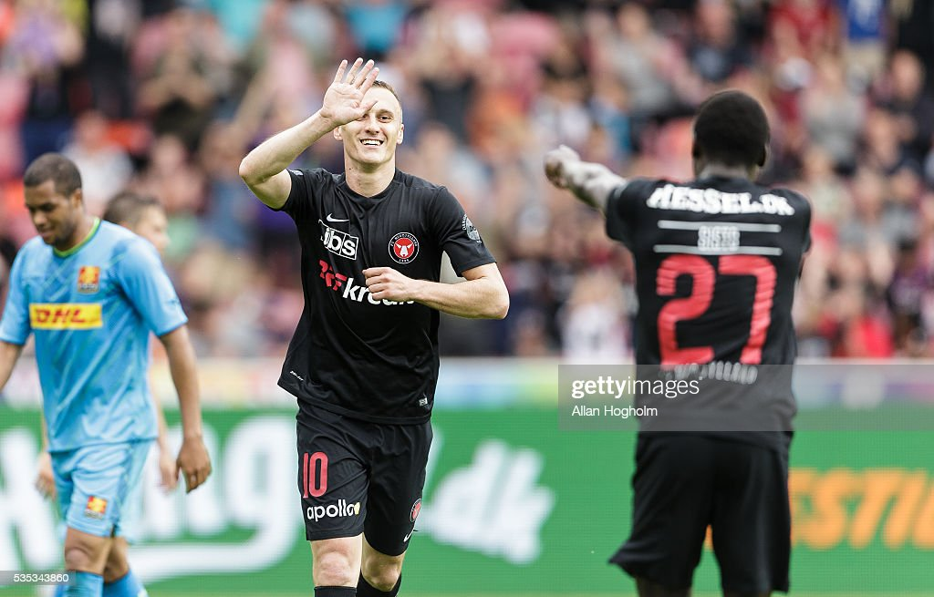 Pione Sisto of FC Midtjylland and Martin Pusic of FC Midtjylland celebrates after scoring their fourth goal during the Danish Alka Superliga match between FC Midtjylland and FC Nordsjalland at MCH Arena on May 29, 2016 in Herning, Denmark.