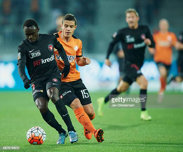 Pione Sisto of FC Midtjylland and Patrick Da Silva of Randers FC compete for the ball during the Danish Alka Superliga match between FC Midtjylland...