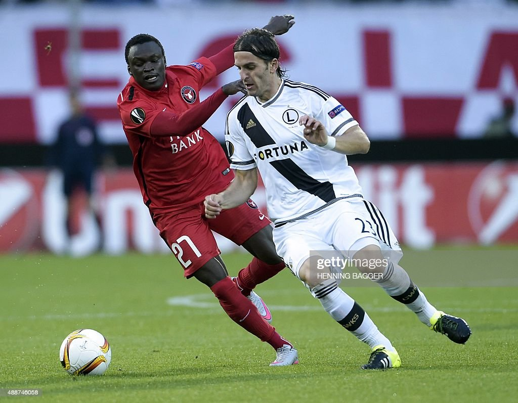 Pione Sisto of FC Midtjylland and Stojan Vranjes of Legia Warszawa vie for the ball during the UEFA Europa League Group D football match between FC...