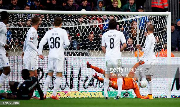 Pione Sisto of FC Midtjylland scores the 20 goal against Goalkeeper Stephan Andersen of FC Copenhagen during the Danish Alka Superliga match between...