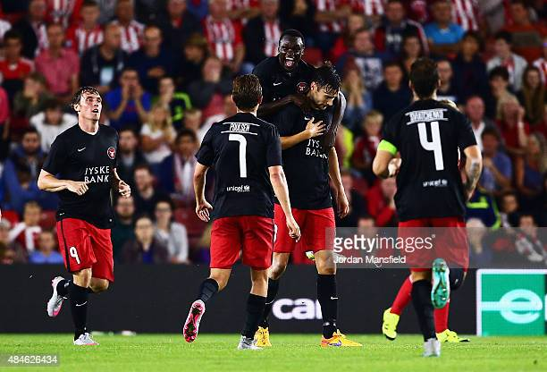 Pione Sisto of Midtjylland celebrates with goalscorer Tim Sparv after the opening goal during the UEFA Europa League Play Off Round 1st Leg match...