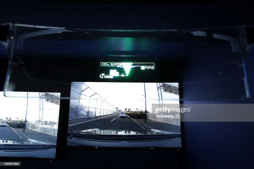 Pioneer Corp.'s Carrozzeria Cyber Navi AR heads-up display (HUD) is demonstrated at the Tokyo Auto Salon 2013 at Makuhari Messe in Chiba, Japan, on Friday, Jan. 11, 2013. The Tokyo Auto Salon runs until Jan. 13. Photographer: Kiyoshi Ota/Bloomberg via Getty Images