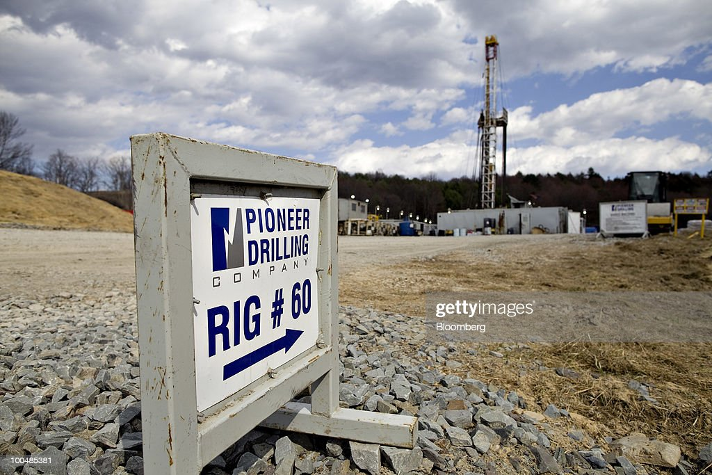A Pioneer Drilling Co. sign stands at the entrance to an Alta Resources LLC natural gas well site near Montrose, Pennsylvania, U.S., on Monday, April 5, 2010. Companies are spending billions to dislodge natural gas from a band of shale-sedimentary rock called the Marcellus shale that underlies Pennsylvania, West Virginia and New York. The band of rock, so designated because it pokes through near a city of that name in northern New York, may contain 262 trillion cubic feet of recoverable gas, the U.S. Department of Energy estimates. Photographer: Daniel Acker/Bloomberg via Getty Images