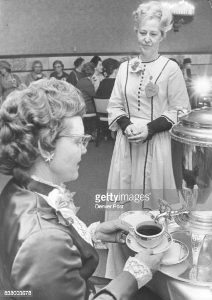 Pioneer Mood at Party Mrs Norman King pours for Mrs H M Forde at Colorado Cowbelles' Tea which honored wives of state solons Credit Denver Post