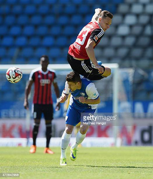 Piotr Cwielong of Bochum and Robert Bauer of Ingolstadt compete for the ball during the Second Bundesliga match between VfL Bochum and FC Ingolstadt...