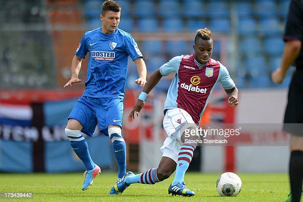 Piotr Cwielong of Bochum vies with Yacouba Sylla of Aston Villa during the preseason friendly match between VfL Bochum and Aston Villa at Rewirpower...