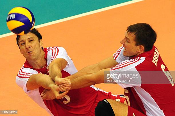 Piotr Gruszka and Bartosz Kurek of Poland hit back the ball during the European Volleyball Championships men's play off round match Poland vs...