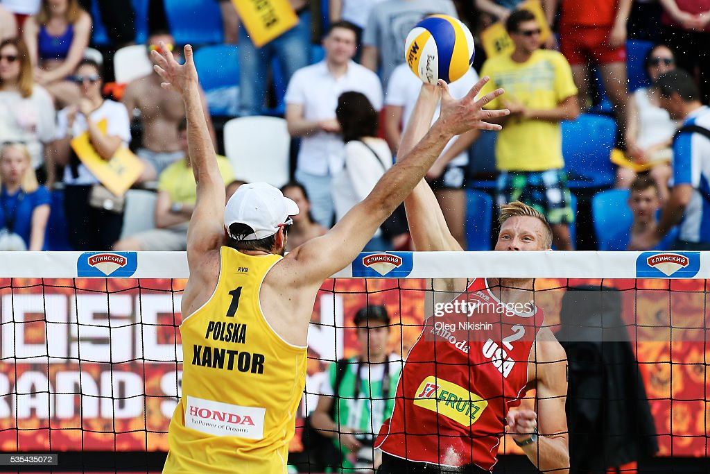 Piotr Kantor of Poland (L) and Casey Patterson of USA duel at the net during a game between USA and Poland on day 6 of the FIVB Moscow Grand Slam at sports complex Dynamo Vodny Stadium on May 29, 2016 in Moscow, Russia.
