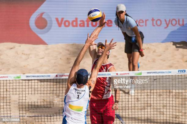 Piotr Kantor of Poland spikes the ball during the semi final match against Phil Dalhausser and Nick Lucerna of the United States at the Swatch Beach...