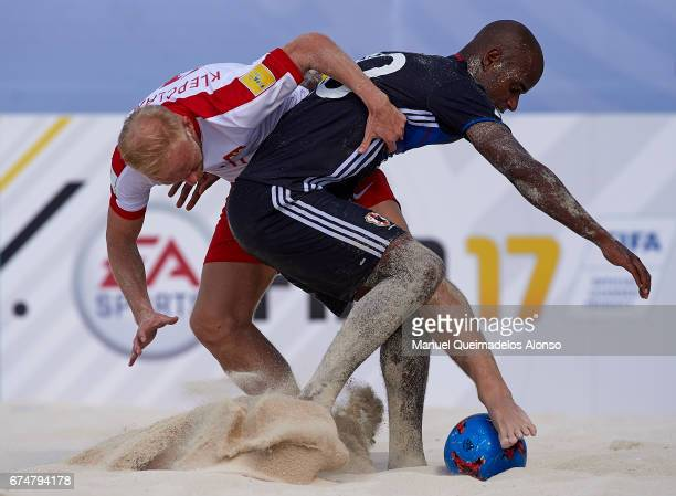 Piotr Klepczarek of Poland competes for the ball with Ozu Moreira of Japan during the FIFA Beach Soccer World Cup Bahamas 2017 group D match between...