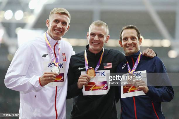 Piotr Lisek of Poland silver Sam Kendricks of the United States gold and Renaud Lavillenie of France bronze pose with their medals for the Men's Pole...