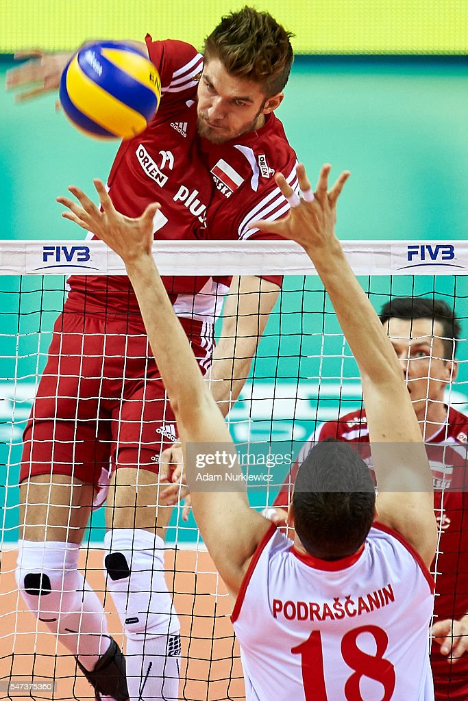 Piotr Nowakowski from Poland attacks against Marko Podrascanin from Serbia while the FIVB World League volleyball match between Poland and Serbia at...