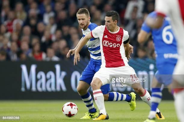 Piotr Parzyszek of PEC Zwolle Nick Viergever of Ajax during the Dutch Eredivisie match between Ajax Amsterdam and PEC Zwolle at the Amsterdam Arena...