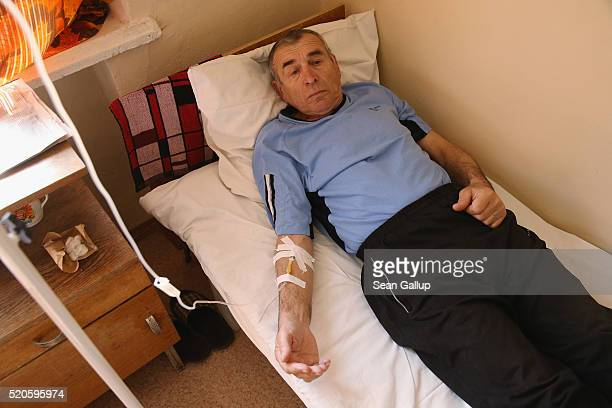 Piotr Treskunov undergoes chemotherapy for cancer to his larynx at the oncology clinic on April 6 2016 in Gomel Belarus Dr Vladimir Tatchykhin head...