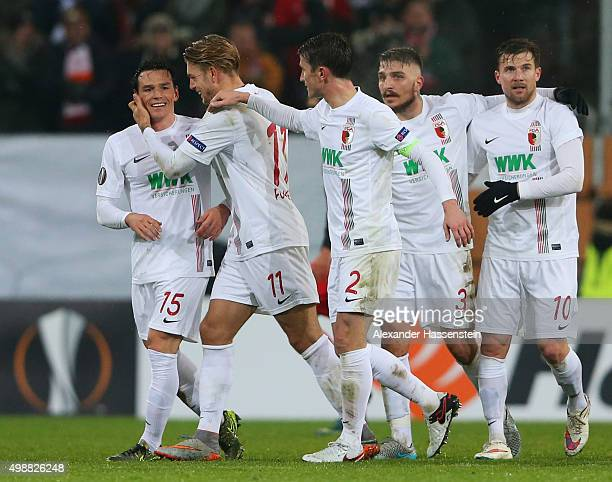 Piotr Trochowski of Augsburg celebrates with team mates as he scores their first goal during the UEFA Europa League Group L match between FC Augsburg...