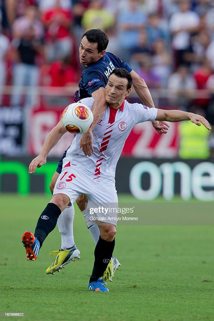 <a gi-track='captionPersonalityLinkClicked' href=/galleries/search?phrase=Piotr+Trochowski&family=editorial&specificpeople=635014 ng-click='$event.stopPropagation()'>Piotr Trochowski</a> of Sevilla FC competes for the ball with Nicolas Hofler of SC Freiburg during the UEFA Europa League group H match between Sevilla FC and SC Freiburg at Estadio Ramon Sanchez Pizjuan on October 3, 2013 in Seville, Spain.