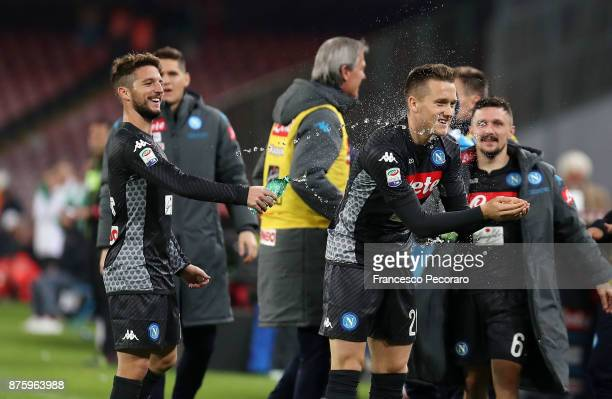 Piotr Zielinski and Dries Mertens of SSC Napoli celebrate the 20 goal scored by Piotr Zielinski during the Serie A match between SSC Napoli and AC...