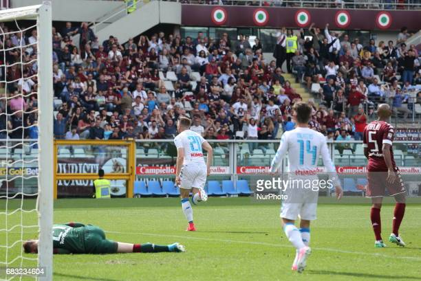 Piotr Zielinski celebrates after scoring during the Serie A football match between Torino FC and SSC Napoli at Olympic stadium Grande Torino on may...
