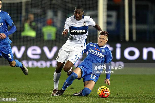 Piotr Zielinski of Empoli FC battles for the ball with Geoffrey Kondogbia of FC Internazionale Milano during the Serie A match between Empoli FC and...