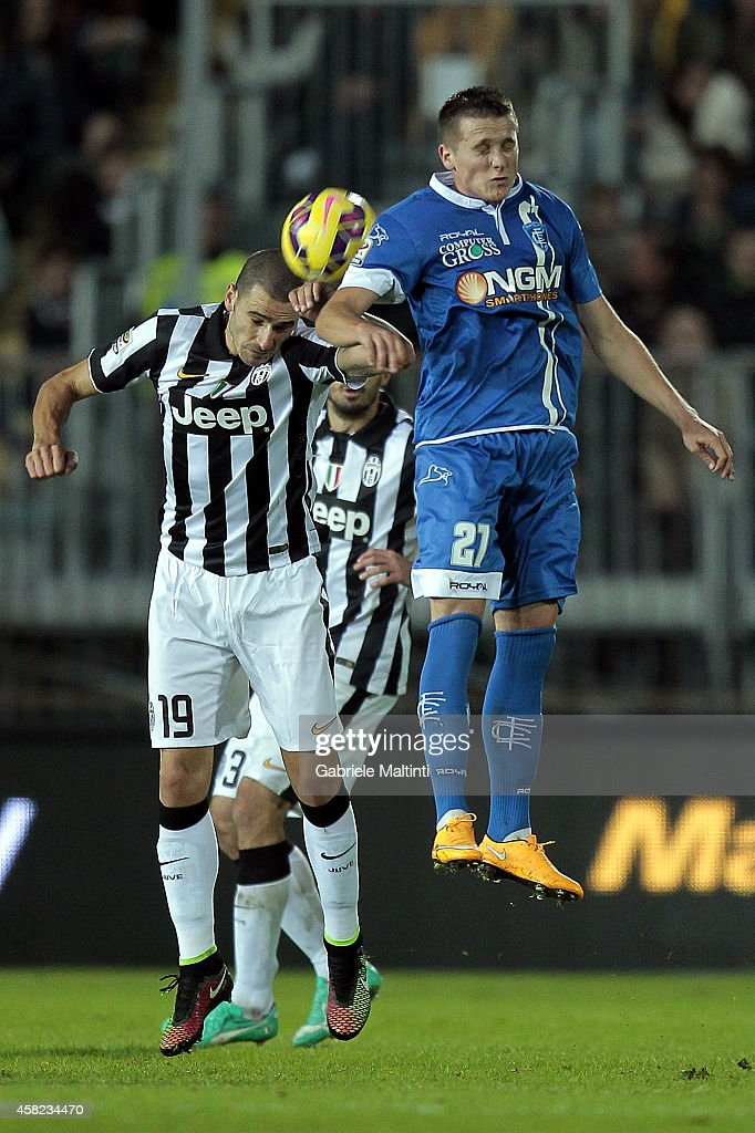 Piotr Zielinski of Empoli FC battles for the ball with Leonardo Bonucci of Juventus FC during the Serie A match between Empoli FC and Juventus FC at Stadio Carlo Castellani on November 1, 2014 in Empoli, Italy.