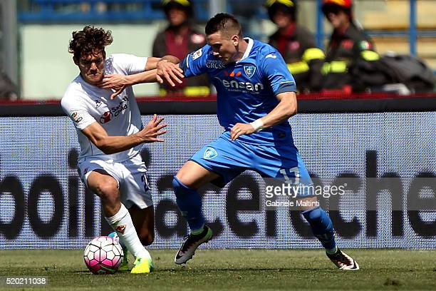 Piotr Zielinski of Empoli FC battles for the ball with Marcos Alonso of ACF Fiorentina during the Serie A match between Empoli FC and ACF Fiorentina...