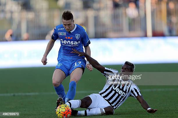 Piotr Zielinski of Empoli FC battles for the ball with Paul Pogba of Juventus FC during the Serie A match between Empoli FC and Juventus FC at Stadio...