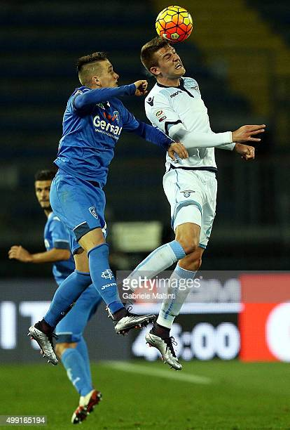 Piotr Zielinski of Empoli FC battles for the ball with Sergej SavicMilinkovic of SS Lazio during the Serie A match between Empoli FC and SS Lazio at...