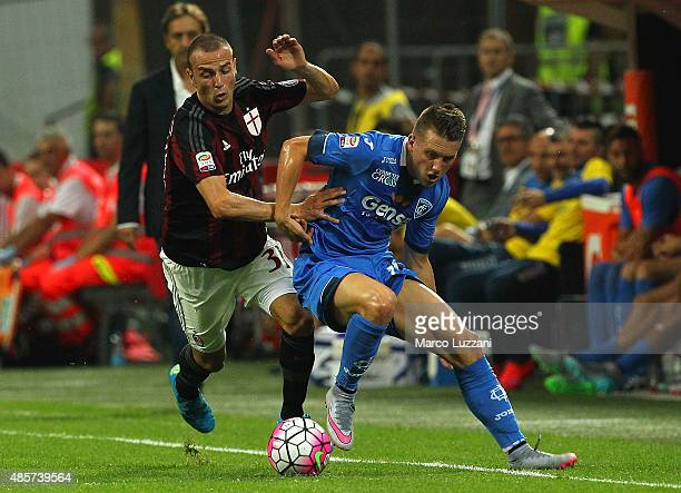 Piotr Zielinski of Empoli FC competes for the ball with of AC Milan during the Serie A match between AC Milan and Empoli FC at Stadio Giuseppe Meazza...
