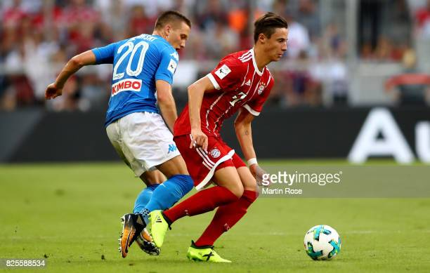 Piotr Zielinski of Napoloi and Marco Friedl of Muenchen battle for the ball during the Audi Cup 2017 match between SSC Napoli and FC Bayern Muenchen...
