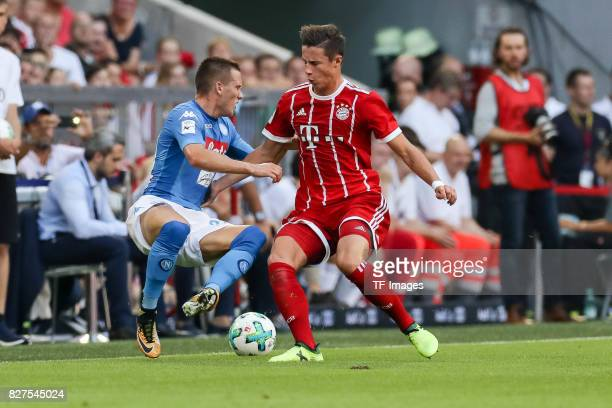 Piotr Zielinski of Neapel and Marco Friedl of Bayern Muenchen battle for the ball during the Audi Cup 2017 match between SSC Napoli and FC Bayern...