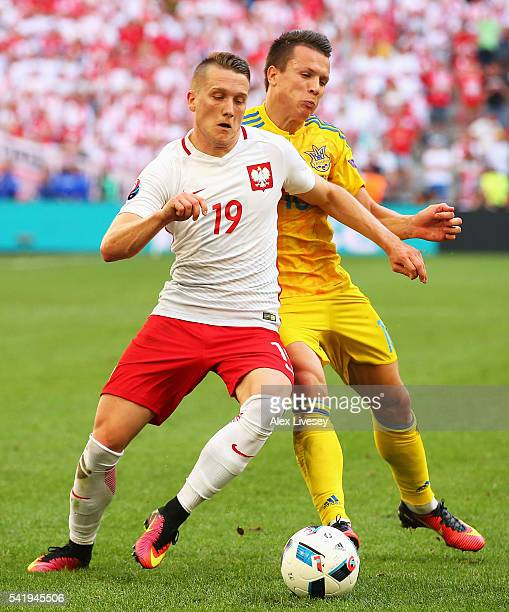Piotr Zielinski of Poland competes for the ball with a Ukraine defender during the UEFA EURO 2016 Group C match between Ukraine and Poland at Stade...