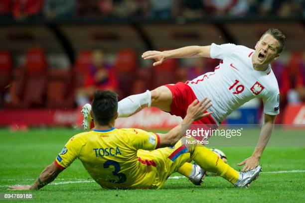 Piotr Zielinski of Poland fouled by Alin Tosca of Romania during the FIFA World Cup 2018 Qualifying Group E match between Poland and Romania at PGE...