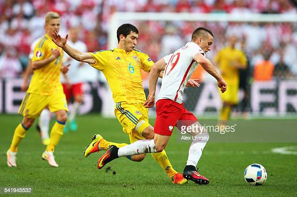 Piotr Zielinski of Poland is tackled by Taras Stepanenko of Ukraine during the UEFA EURO 2016 Group C match between Ukraine and Poland at Stade...