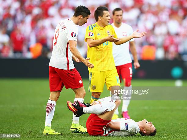Piotr Zielinski of Poland lies on the floor injured during the UEFA EURO 2016 Group C match between Ukraine and Poland at Stade Velodrome on June 21...