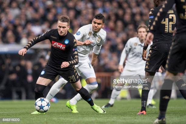 Piotr Zielinski of SSC Napoli fights for the ball with Carlos Henrique Casemiro of Real Madrid during the match Real Madrid vs Napoli part of the...