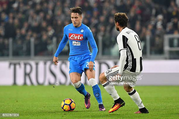 Piotr Zielinski of SSC Napoli in action against Claudio Marchisio of Juventus FC during the Serie A match between Juventus FC and SSC Napoli at...