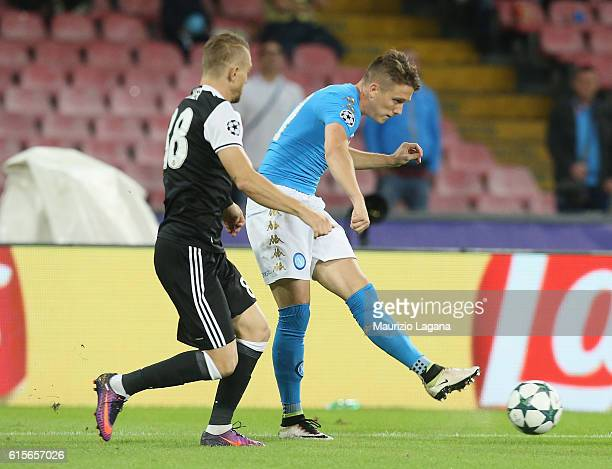 Piotr Zielinsky of Napoli competes for the ball with Caner Erkin of Besiktas during the UEFA Champions League match between SSC Napoli and Besiktas...