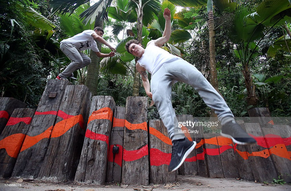 Pip Andersen (L) and Tim Shieff, both professional freerunner and parkour experts, jump inside the Eden's Rainforest Biome on July 29, 2013 in St Austell, England. Pip Andersen and Tim Shieff who are both members of the pro freerunning team Storm Freerun, were at the Eden Project to help make a promotional video for the Cornish attraction. Following a record dry July, visitor numbers to the region are reported to be higher than previous years and many attractions and resorts are hoping for a busy summer season.