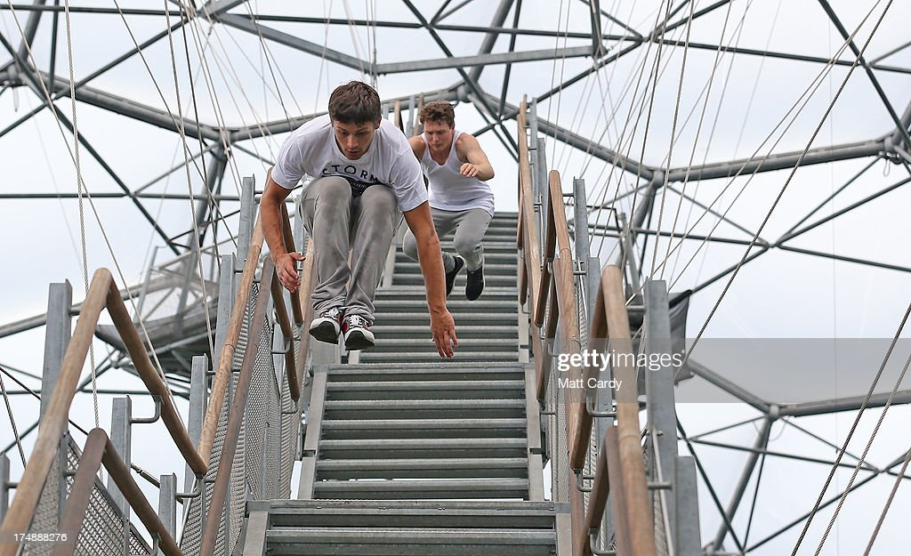 Pip Andersen professional freerunner and parkour expert is followed by Tim Shieff as they jump down the stairs to the viewing platform below the roof of the Eden's Rainforest Biome on July 29, 2013 in St Austell, England. Pip Andersen and Tim Shieff who are both members of the pro freerunning team Storm Freerun, were at the Eden Project to help make a promotional video for the Cornish attraction. Following a record dry July, visitor numbers to the region are reported to be higher than previous years and many attractions and resorts are hoping for a busy summer season.