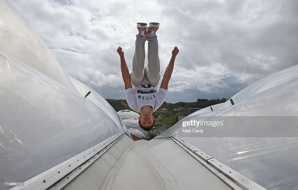 <a gi-track='captionPersonalityLinkClicked' href=/galleries/search?phrase=Pip+Andersen&family=editorial&specificpeople=5512792 ng-click='$event.stopPropagation()'>Pip Andersen</a> professional freerunner and parkour expert somersaults on the roof of the Eden's Rainforest Biome on July 29, 2013 in St Austell, England. <a gi-track='captionPersonalityLinkClicked' href=/galleries/search?phrase=Pip+Andersen&family=editorial&specificpeople=5512792 ng-click='$event.stopPropagation()'>Pip Andersen</a> and Tim Shieff who are both members of the pro freerunning team Storm Freerun, were at the Eden Project to help make a promotional video for the Cornish attraction. Following a record dry July, visitor numbers to the region are reported to be higher than previous years and many attractions and resorts are hoping for a busy summer season.