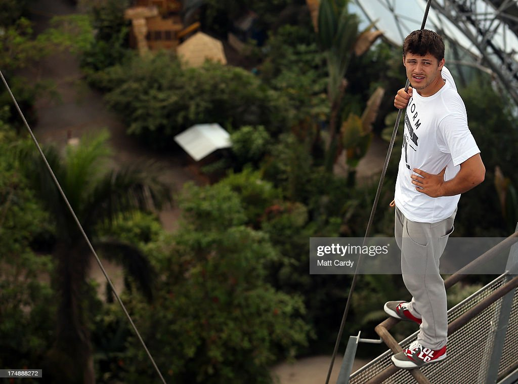 Pip Andersen professional freerunner and parkour expert stands on the edge of the railing to the viewing platform below the roof of the Eden's Rainforest Biome on July 29, 2013 in St Austell, England. Pip Andersen and Tim Shieff who are both members of the pro freerunning team Storm Freerun, were at the Eden Project to help make a promotional video for the Cornish attraction. Following a record dry July, visitor numbers to the region are reported to be higher than previous years and many attractions and resorts are hoping for a busy summer season.