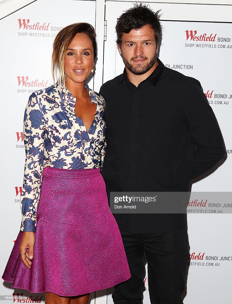 Pip Edwards and <a gi-track='captionPersonalityLinkClicked' href=/galleries/search?phrase=Adam+Ashley-Cooper&family=editorial&specificpeople=637621 ng-click='$event.stopPropagation()'>Adam Ashley-Cooper</a> pose at the Westfield Autumn/Winter 2013 launch at Pelicano Bar on March 19, 2013 in Sydney, Australia.