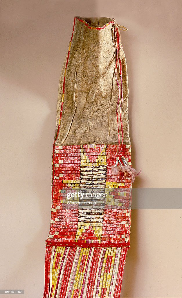 Pipe bag made from buffalo skin and decorated with quillwork, Used to hold a pipe, tobacco, tamping stick and strike a light. USA. Plains Indian.