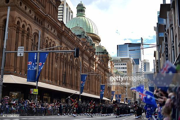 A pipe band marches along George Street during the Anzac Day parade in Sydney on April 25 2015 Record numbers of Australians and New Zealanders...