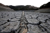 A pipe emerges from dried and cracked earth that used to be the bottom of the Almaden Reservoir on January 28 2014 in San Jose California Now in its...